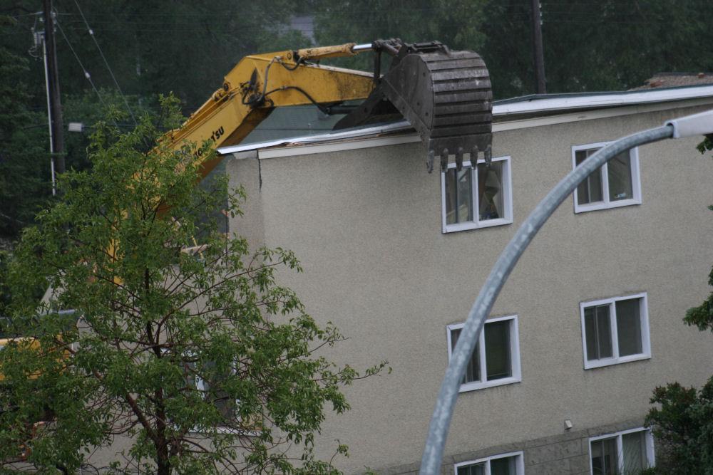"""Rude Awakening""...making way for new, large condominiums along White Ave. in Edmonton, Alberta"