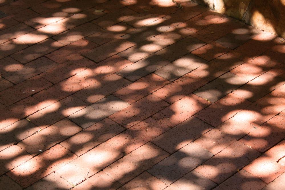 Shadows on brick sidewalk, downtown Dallas TX