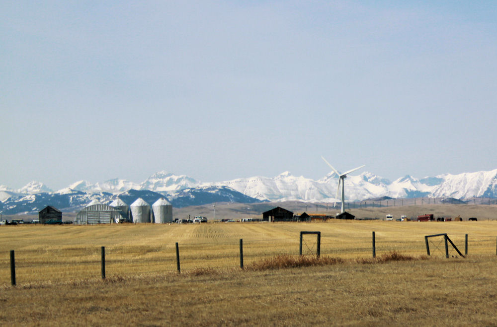 Wind Power, farm and Rocky Mountains, South of Calgary, Alberta