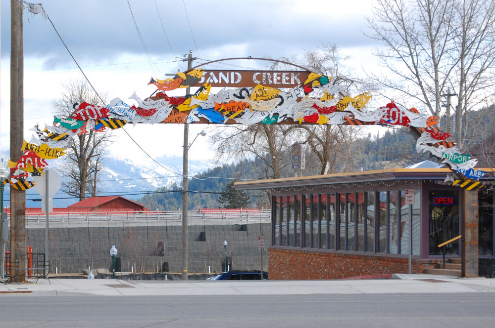 Sand Creek street entrance archway made of repurposed road signs, Sandpoint, Idaho