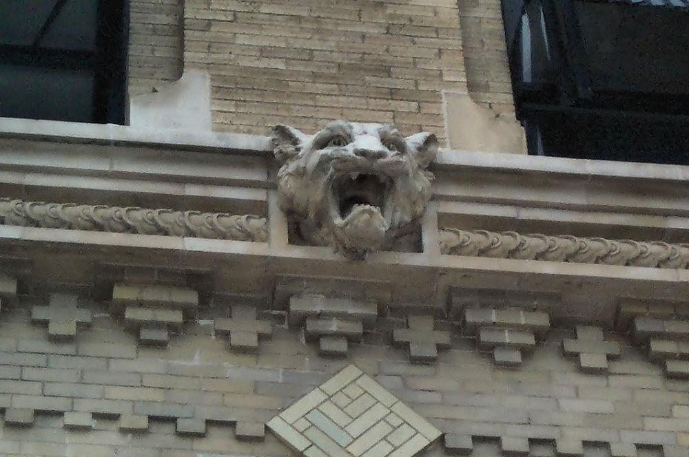 Carved lioness head and details on the Flatiron Building, downtown Fort Worth, Texas