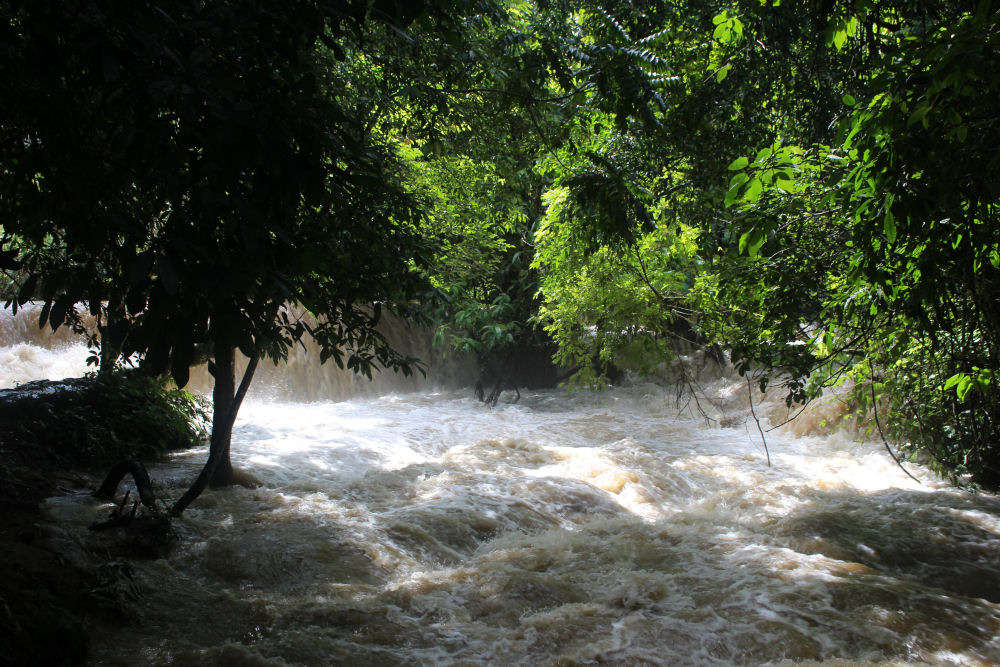 Kuang Si Falls, flooded due to rainy season, near Luang Prabang, Laos