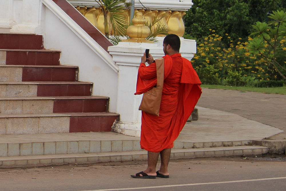 Monk taking photos, Vientiane, Laos