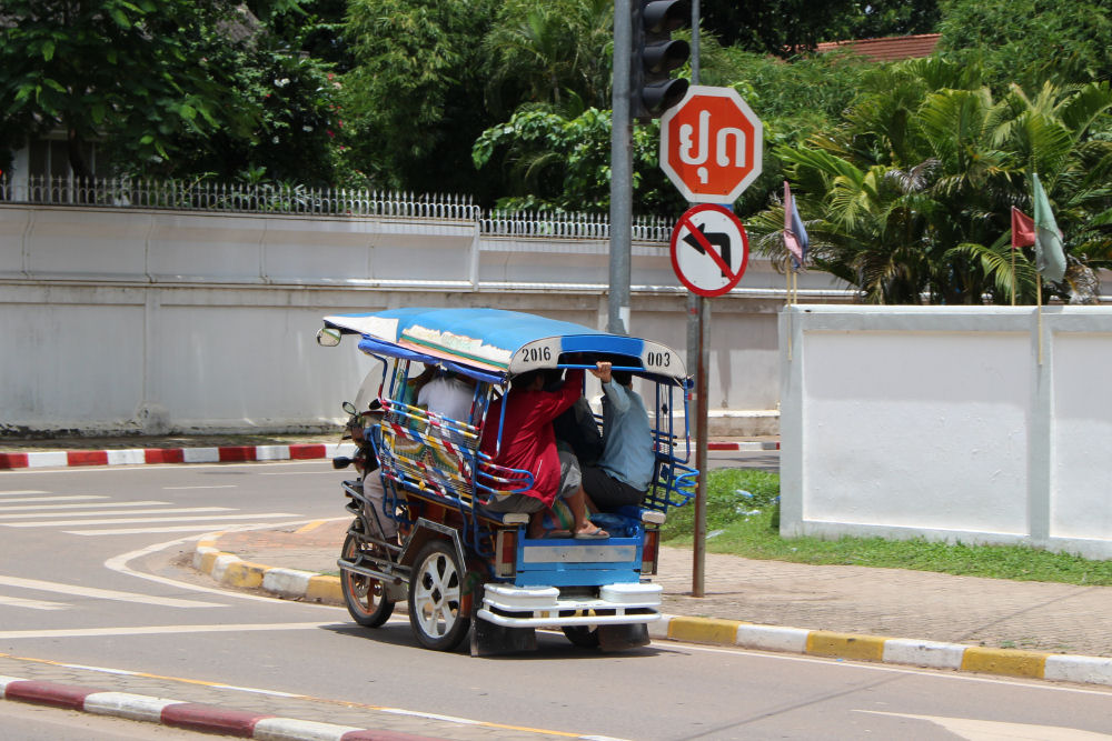 Over-loaded tuk-tuk, Vientiane, Laos