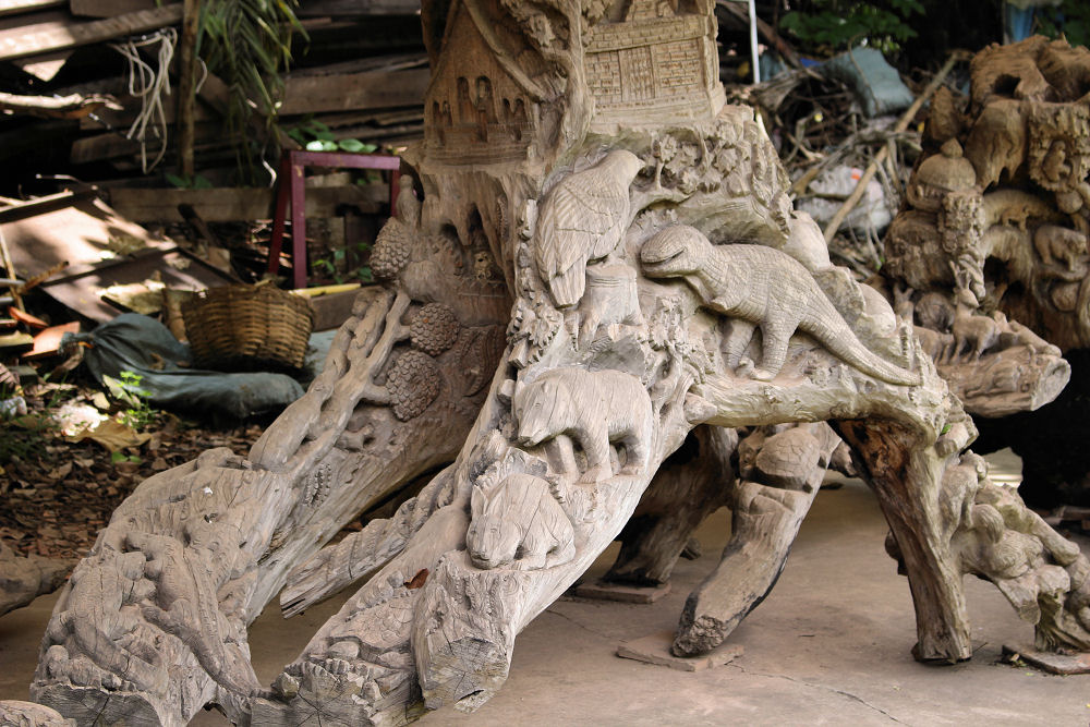 Vientiane, Laos - carved tree trunks at Pha That Luang temple