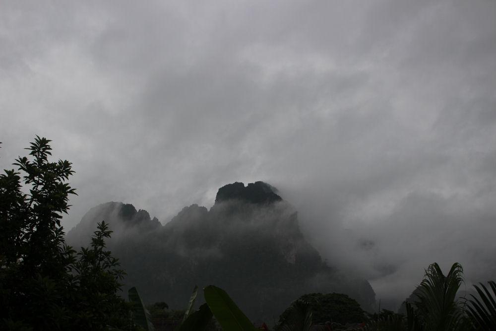 Vang Vieng, Laos - misty limestone karst hills