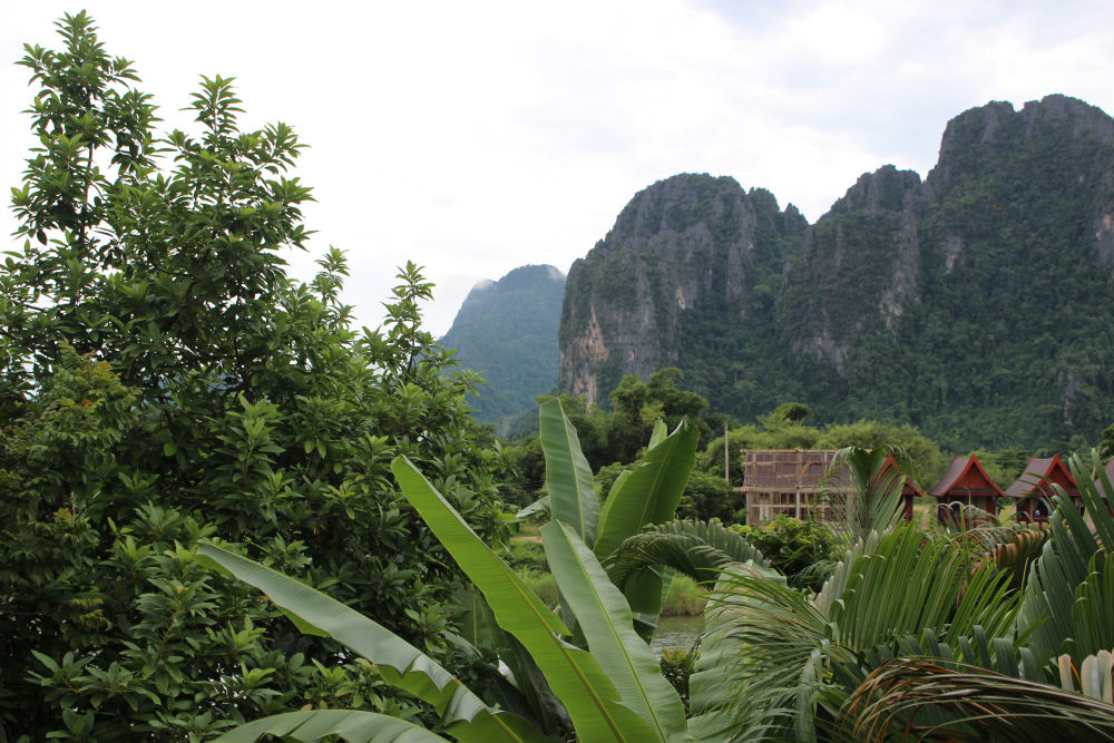 Vang Vieng, Laos hotel room view of limestone karst hills and the Nam Song River