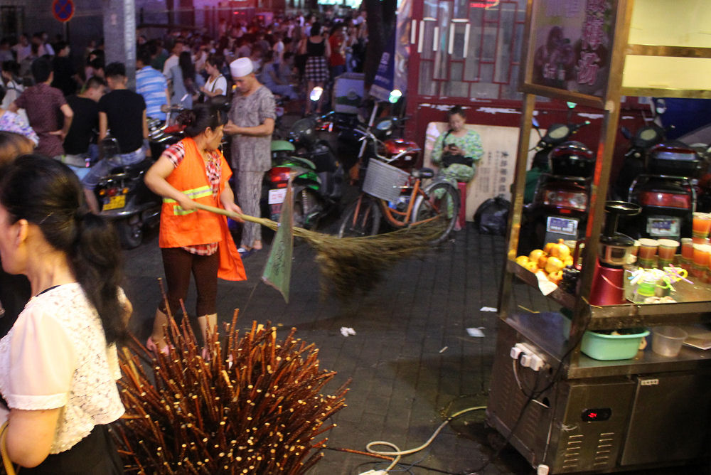 Night market in Xi'an, China - street sweeper with a whistle - get the hell outa her way!